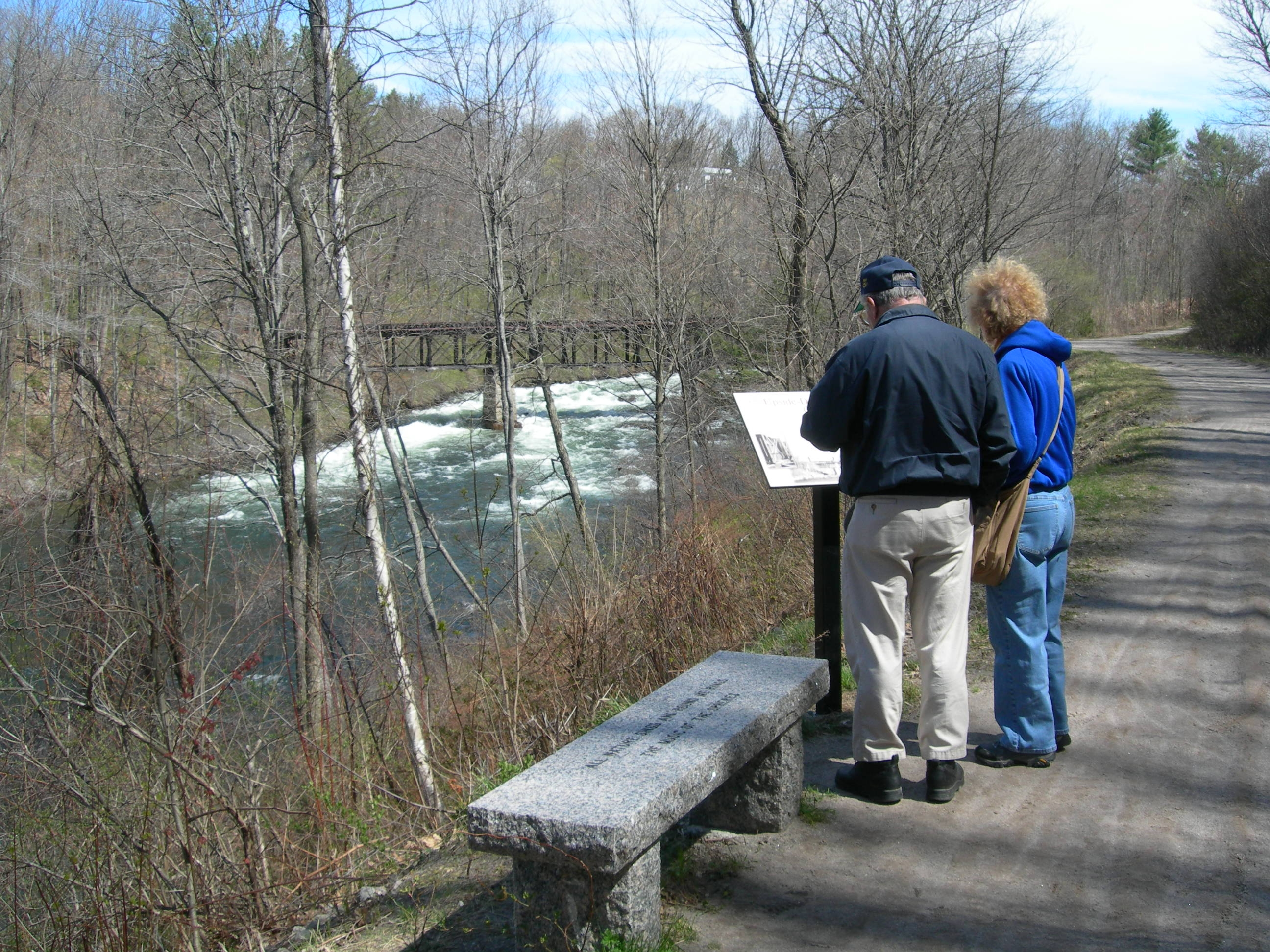 Egon and Ruthann at marker w rapids in background.JPG